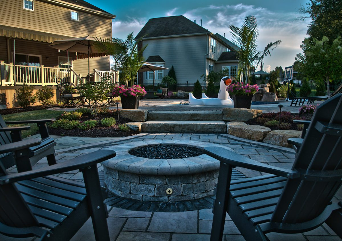Resort Style Backyard Redesign with custom pool and firetable